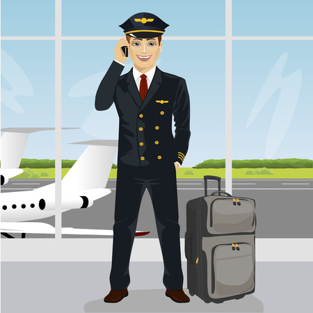 observation: Young pilot talking on the phone with luggage in front of an airport observation deck