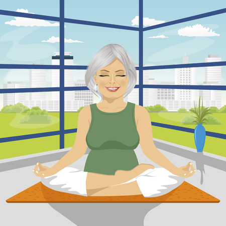 happy couple beach: senior woman doing yoga exercises in lotus position sitting on a mat