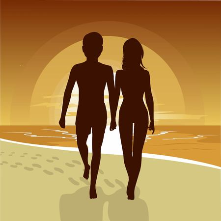 silhouette of happy couple walking along the beach at sunset