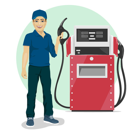 Gas station worker holding a petrol pump standing next to fuel dispenser