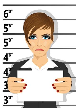 female prisoner: Arrested businesswoman posing for a mugshot holding a signboard