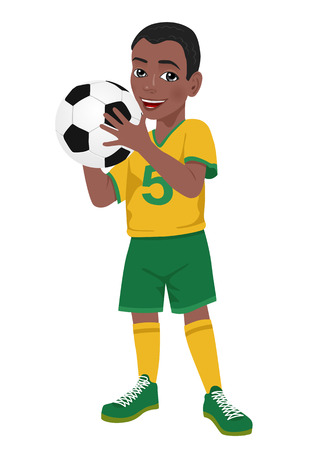 african american little boy soccer player in yellow green uniform holds a ball