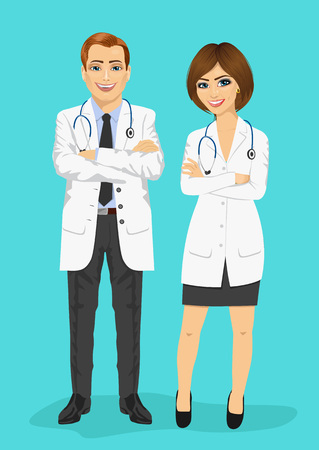 arms folded: male and female doctors standing with arms folded isolated on blue background