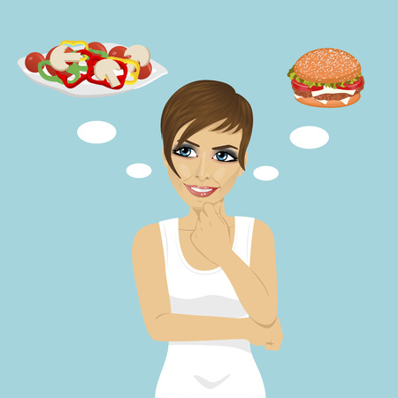 young woman choosing between hamburger and salad. Healthy and junk food concept over blue background