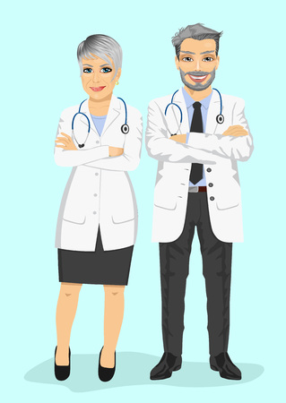 arms folded: mature doctors standing with arms folded isolated on blue background