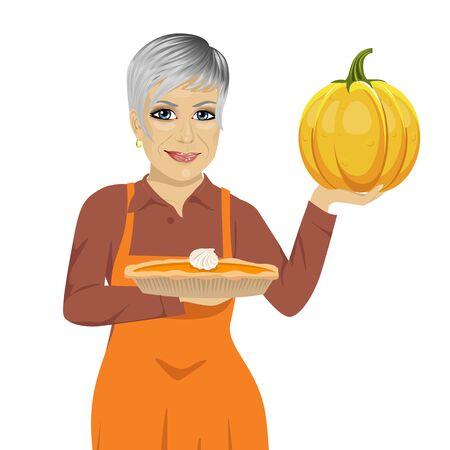 freshly: senior woman holding freshly baked homemade pumpkin pie over white background