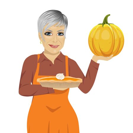 senior woman holding freshly baked homemade pumpkin pie over white background