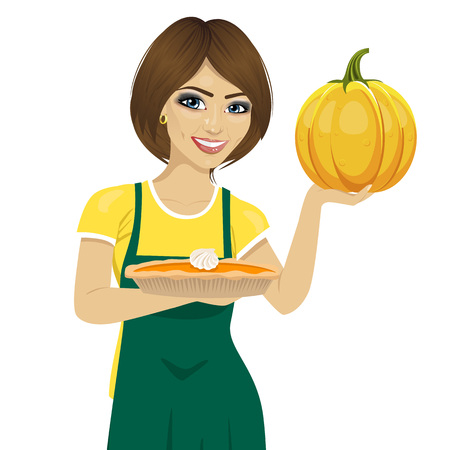 freshly baked: young beautiful woman holding freshly baked homemade pumpkin pie over white background