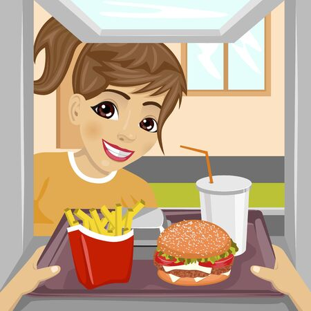 hands giving a tray with fast food meals through a drive-thru window to happy teenager girl