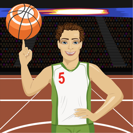 spinning: Young man spinning basketball ball with his finger on court in arena