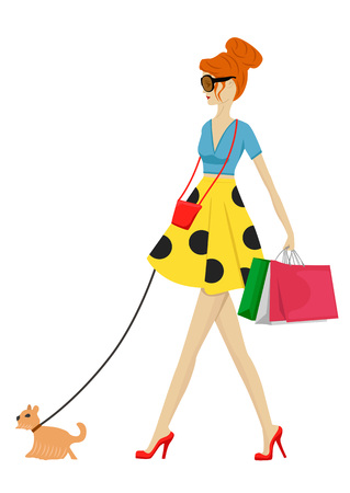 Fashion woman walking with dog and shopping bags