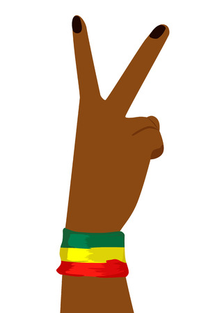 Hand of african woman wearing a flag of Ethiopia showing victory sign