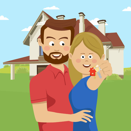 Young couple holding keys of their new house.