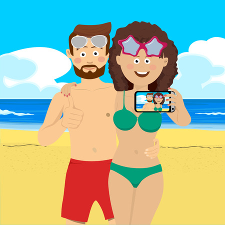 Young couple at the beach taking selfie picture