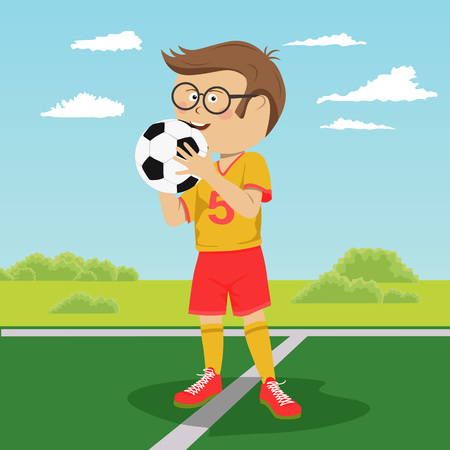 Teenager boy with glasses poses with soccer ball on field Vectores