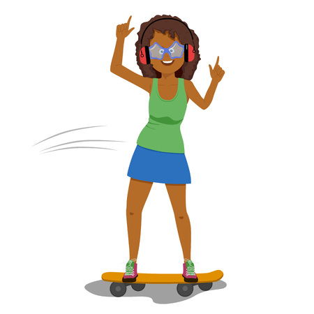 Happy funny african american woman in headphones listening to music while riding a skateboard isolated