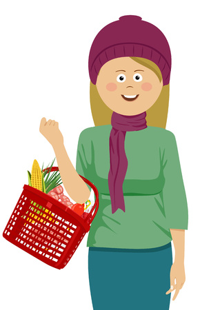 Young woman holding a shopping basket filled with vegetables and fruits wearing knitted hat and scarf