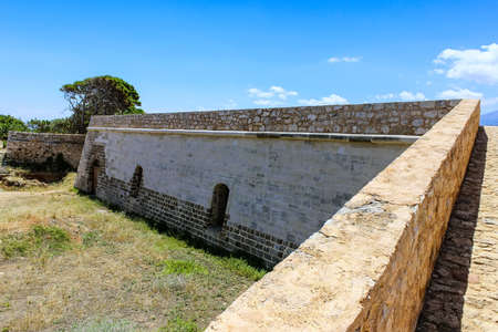 Casemates and walls of the ancient fortress in Greece Stock Photo