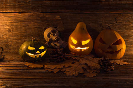 all saints day: Three glowing jack lantern on the eve of All Saints Day. Halloween card. Stock Photo