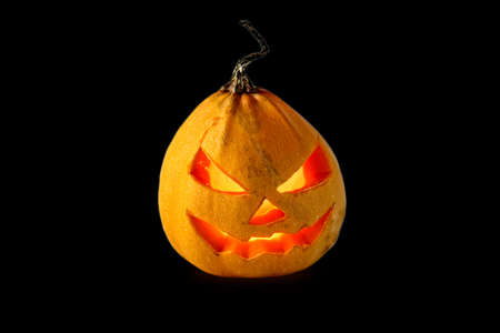 Scary Halloween Pumpkin With Burning Eyes Isolated On Black Stock Photo Picture And Royalty Free Image Image 65304660