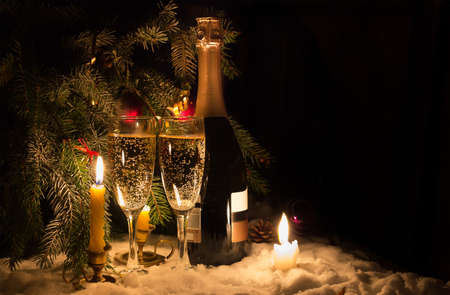 Champagne glasses and candles in Christmas eve Stock Photo