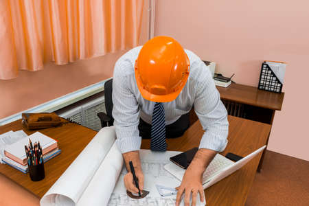 refinement: The architect works with the drawing. Drawing a construction plan. Refinement of planning details. Stock Photo