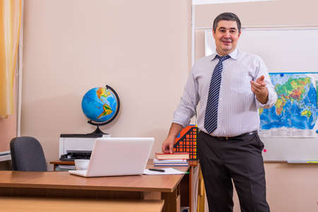 teaching material: The teacher speaks to the audience. There is a lecture. The teacher makes a report. Explanation of the new teaching material. Stock Photo