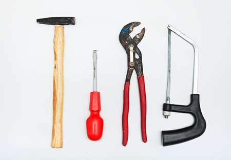 A set of metalwork tools. Hammer, screwdriver, hacksaw, adjustable wrench and screwdriver. Stock Photo