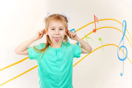 little girl indulges - teases and shows tongue Stock Photo