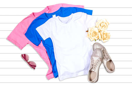 Pink, White and Blue T-shirts - Flat Lay Mockup  on a White Wooden Background Reklamní fotografie