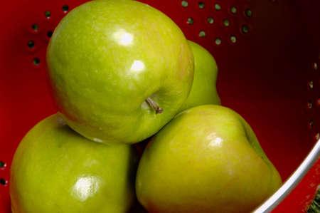 granny smith: Green Apple in Colander - Granny Smith Apples Stock Photo