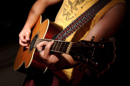 played: Acoustic Guitar being played Stock Photo