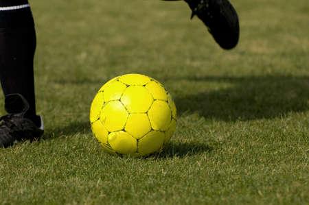futball: Yellow Soccer - Football getting kicked Stock Photo