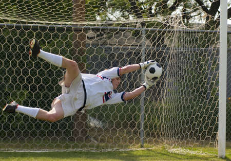 sky dive: Soccer Football Goalie making diving save