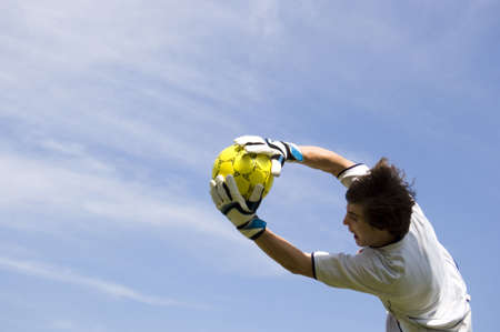 Soccer - Football Goal Keeper Making Diving Save Banco de Imagens