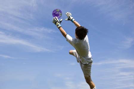 diving save: Soccer Football Goalie making diving save