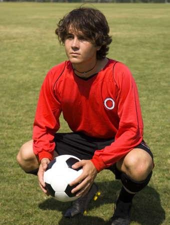 fútbol jugador: F�tbol F�tbol jugador con jersey rojo