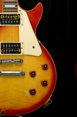 sun burst: Gibson Les Paul sun burst guitar on stand