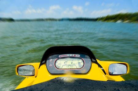 watercraft: Personal watercraft, waverunner, jetski speeding across lake