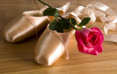 lyrical dance: new ballet slippers - shoes with rose Stock Photo