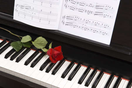 half note: Sheet music with rose piano Stock Photo