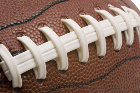 pigskin: Extreme closeup of american football laces, detail in grain of leather is very sharp