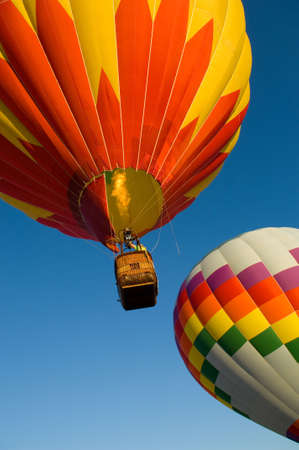 Beautiful hot air balloons against dark blue sky with basket photo