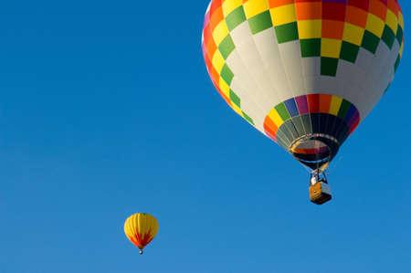 Beautiful hot air balloon against dark blue sky with basket photo