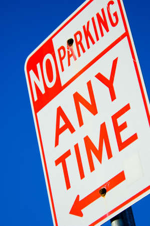 sign with no parking anytime against vibrant blue sky Stock Photo - 552157