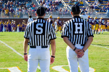 played: American Football played by young men with game official linesman and side-judge referee