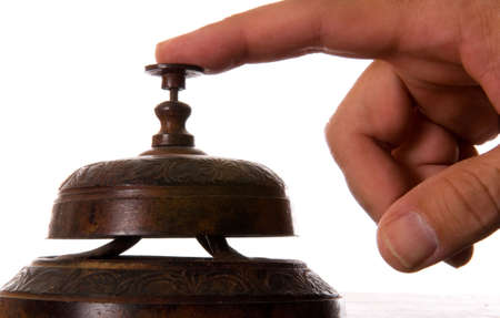 Antique service bell being rung against white background photo