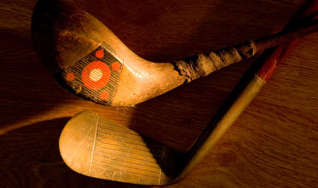 Old, vintage, antique golf clubs painted with light from a flashlight