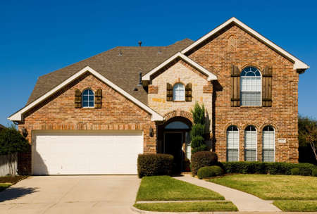 security shutters: beautiul two-story home with beautiful cloudless blue sky in background
