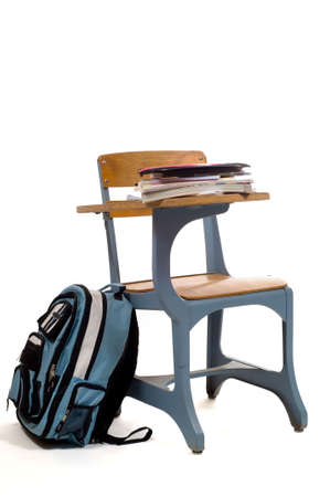 bookbag: School desk with miscellaneous supplies and a back pack - bookbag